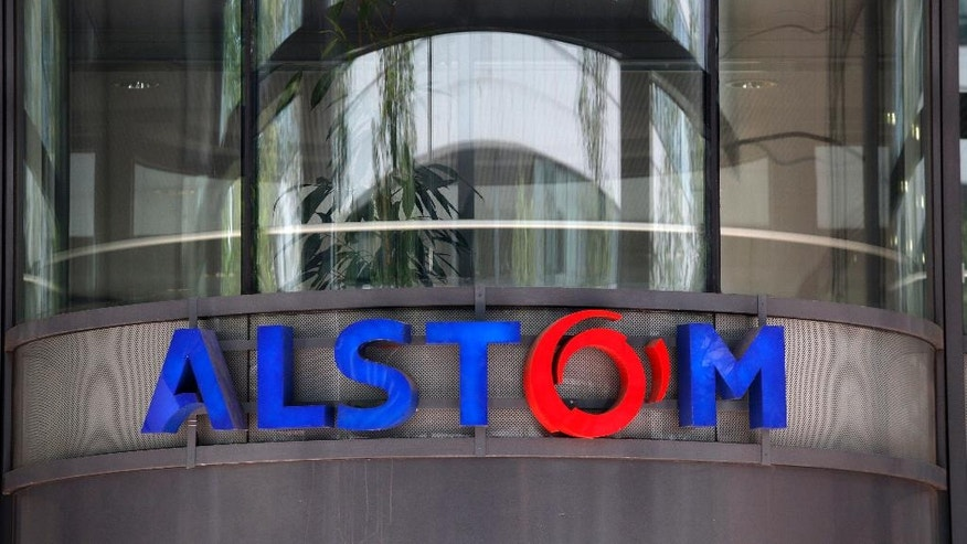 FILE - This Wednesday, April 30, 2014 file photo shows the company logo of Alstom at the headquarters of the leading global maker of high-speed trains, power plants and grids, in Levallois-Perret, outside Paris, France. France's Socialist government vows to maintain the train making site of rail giant Alstom in the country despite the company's decision to end its production. (AP Photo/Christophe Ena, File)