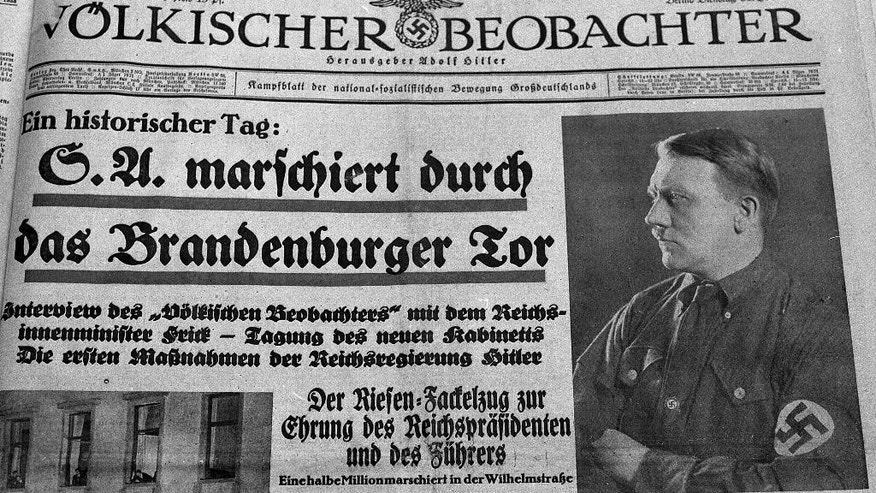 "FILE - The Jan 20, 1983 b/w file photo shows the front page of the Jan. 31, 1933 edition of the German Nazi party newspaper ""Voelkischer Beobachter"" . Headline reads : SA marches through Brandenburg Gate.  At right a picture of  Adolf Hitler. A leading member of the nationalist party Alternative for Germany is facing fierce criticism after calling for a racially charged term once favored by the Nazis to be rehabilitated. Party co-chairwoman Frauke Petry said in an interview published Sunday Sept. 11, 2016  that words such as ""voelkisch"" should be given ""a positive connotation."" Frequently used by the Nazis, the term refers to people who belong to a particular race. (AP Photo/Heribert Proepper,file)"