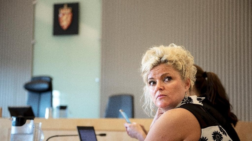 Norwegian hairdresser Merete Hodne sits in a in court in Stavanger Norway Thursday Sept. 8, 2016. A Norwegian court  Monday Sept. 12, 2016  found  hairdresser Merete Hodne  guilty of discrimination for refusing to serve a Muslim woman Malika Bayan who was wearing a hijab. The Jaeren District Court on Monday fined Merete Hodne 10,000 kroner ($1,200) and ordered her to pay 5,000 kroner in court costs.  (Carina Johansen/NTB Scanpix via AP)