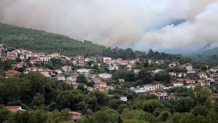 In this Sunday, Sept. 11, 2016 a wildlife approaches the village of Rahoni on the northern Greek island of Thassos. Prime Minister Alexis Tsipras visits the holiday island in northern Greece on Monday, Sept. 12, 2016 where a state of emergency has been declared as a forest fire burns out of control for a third day, gutting homes and small farms. (Eurokinissi via AP)