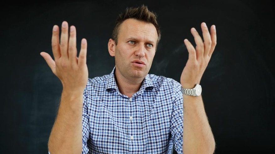 In this photo taken on Thursday, Sept. 1, 2016, Russian opposition activist Alexei Navalny speaks during an interview to the Associated Press in Moscow, Russia. The upcoming Russian parliamentary election is unlikely to give political representation to the urban class which took to the streets to protest vote rigging in 2011 only to be drowned in nationalist euphoria which followed the 2014 annexation of Crimea.  (AP Photo/Pavel Golovkin)