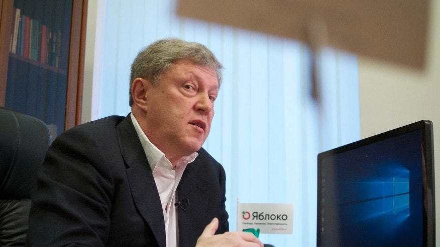 In this photo taken on Monday, Sept. 5, 2016 Grigory Yavlinsky speaks during his interview to the Associated Press in Moscow, Russia. The upcoming Russian parliamentary election is unlikely to give political representation to the urban class which took to the streets to protest vote rigging in 2011 only to be drowned in nationalist euphoria which followed the 2014 annexation of Crimea. (AP Photo/Ivan Sekretarev)