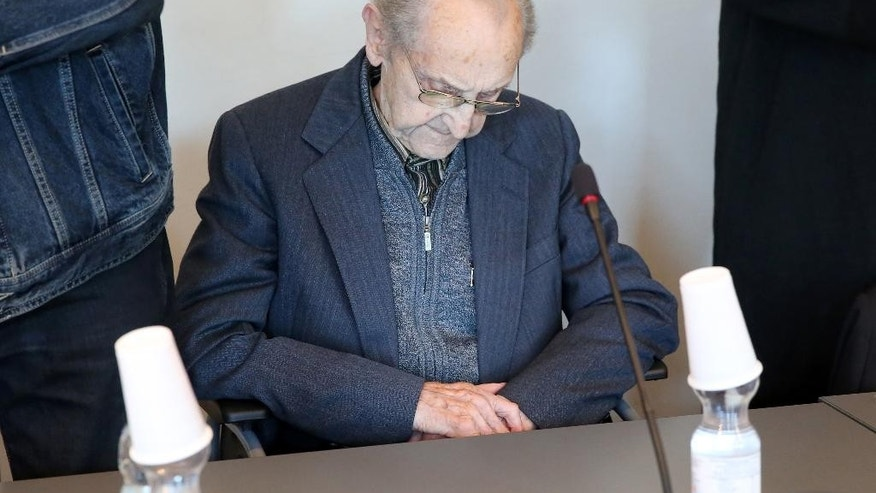 Hubert Zafke sits in a courtroom  ahead of his trial in Neubrandenburg, eastern Germany, Monday, Sept. 12, 2016.  The  former SS medic who served at the Auschwitz death camp has gone on trial in the northern German city of Neubrandenburg, though questions remain about whether the 95-year-old is fit enough for the proceedings to continue. The trial of Hubert Zafke, scheduled to start in February, had already been postponed three times after Presiding Judge Klaus Kabisch said his health was not good enough to proceed, based upon a doctor's assessment.  (Bernd Wuestneck/dpa via AP)