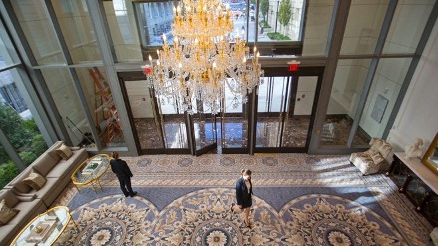 "11th street lobby entrance to the Trump International Hotel in downtown Washington, Monday, Sept. 12, 2016 in Washington. The luxury hotel Donald Trump has built in an iconic downtown Washington building is set to open. The Trump International Hotel will begin serving guests Monday. There won't be any fanfare around the opening, which is known as a ""soft opening."" Grand-opening ceremonies are being planned for October. The Trump Organization won a 60-year lease from the federal government to transform the Old Post Office building on Pennsylvania Avenue into a hotel. (AP Photo/Pablo Martinez Monsivais)"