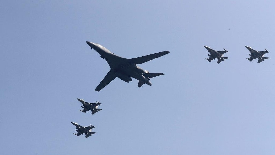 U.S. B-1 bomber, center, flies over Osan Air Base with U.S. jets in Pyeongtaek, South Korea, Tuesday, Sept. 13, 2016. The United States has flown nuclear-capable supersonic bombers over ally South Korea in a show of force meant to cow North Korea after its fifth nuclear test and also to settle rattled nerves in the South. (AP Photo/Lee Jin-man)