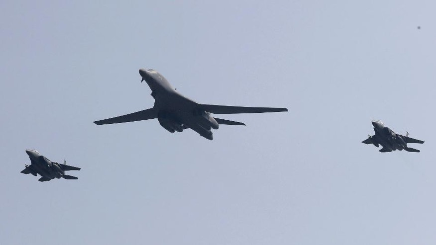 U.S. B-1 bomber, center, flies over Osan Air Base with South Korean jets in Pyeongtaek, South Korea, Tuesday, Sept. 13, 2016. The United States has flown nuclear-capable supersonic bombers over ally South Korea in a show of force meant to cow North Korea after its fifth nuclear test and also to settle rattled nerves in the South. (AP Photo/Lee Jin-man)