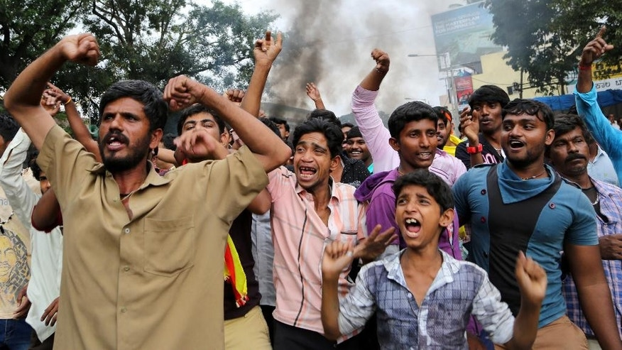 Pro-Karnataka activists are joined by others as they shout slogans against neighboring Tamil Nadu state, during violence in Bangalore, Karnataka state, India, Monday, Sept. 12, 2016. India's top court on Monday ordered the southern state of Karnataka to release water from a disputed river to neighboring Tamil Nadu after violence erupted in both states over water sharing. (AP Photo/Aijaz Rahi)