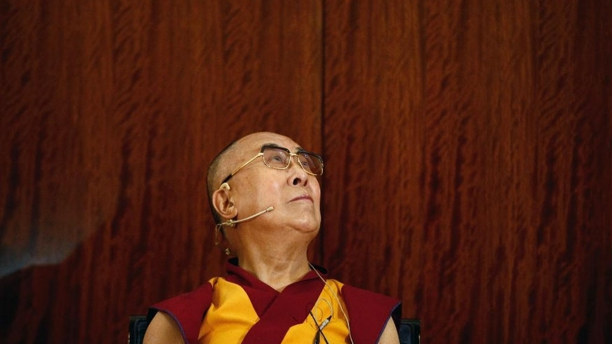 Tibetan spiritual leader, the Dalai Lama pauses, during a press conference , in Paris, Tuesday, Sept. 13, 2016. The Dalai Lama says there should be dialogue with Islamic State extremists to end bloodshed in Syria and Iraq, and argues that religion is never a justification for bloodshed. The spiritual leader is on a six day visit to France. (AP Photo/Thibault Camus)