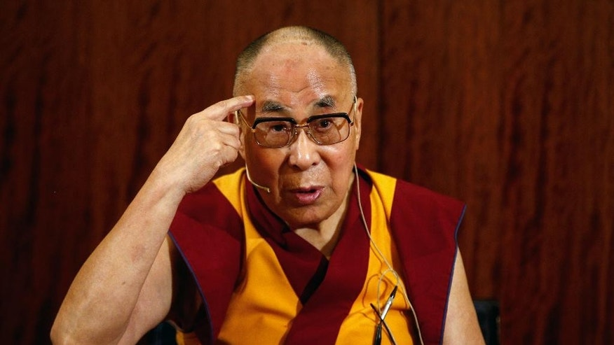 Tibetan spiritual leader, the Dalai Lama gestures during a press conference , in Paris, Tuesday, Sept. 13, 2016. The Dalai Lama says there should be dialogue with Islamic State extremists to end bloodshed in Syria and Iraq, and argues that religion is never a justification for bloodshed. The spiritual leader is on a six day visit to France. (AP Photo/Thibault Camus)