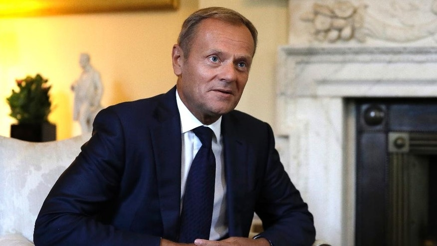 President of the European Council, Donald Tusk listens to Britain's Prime Minister Theresa May inside 10 Downing Street in London, Thursday, Sept. 8, 2016. The two met for a bilateral meeting to discuss Brexit, amid increasing pressure over a lack of detail in the Government's stated strategy. (AP Photo/Kirsty Wigglesworth, pool)