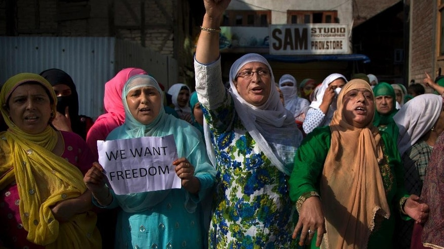 Kashmiri Muslim women shout freedom slogans during a protest after Eid al-Adha prayers in Srinagar, Indian controlled Kashmir, Tuesday, Sept. 13, 2016. Security forces fired tear gas and shotgun pellets to quell protesters in several places, as a security lockdown marred Eid festivities in the troubled region. Shops and businesses were closed, with a curfew in effect in the entire Kashmir Valley. (AP Photo/Dar Yasin)