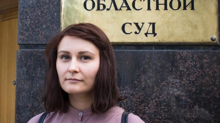In this photo taken on Wednesday, Aug. 10, 2016, Anna Gaskarova, journalist and wife of political prisoner Andrei Gaskarov, stands outside the court house in Tula after the unsuccessful appeal for her husband's early release in Tula, Russia. In 2013, her husband Alexei Gaskarov was imprisoned for his participation in the Bolotnaya protests, convicted of attacking police at the rally. Since then, Anna has repeatedly appealed for her husband's early release, saying that the allegations are false and politicized. (AP Photo/Francesca Ebel)