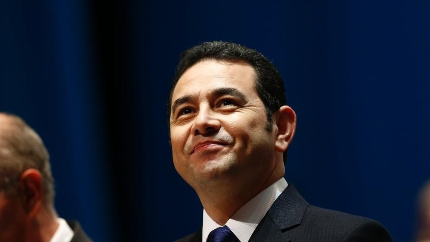 FILE - In this Jan. 14, 2016, file photo, Guatemala's President Jimmy Morales arrives for his inauguration ceremony at the National Theater in Guatemala City. The son and brother of Morales have made statements to prosecutors investigating the misappropriation of funds, on Tuesday, Sept. 13. President Morales says both made their statement in person at the Attorney General's Office. (AP Photo/Moises Castillo, File)