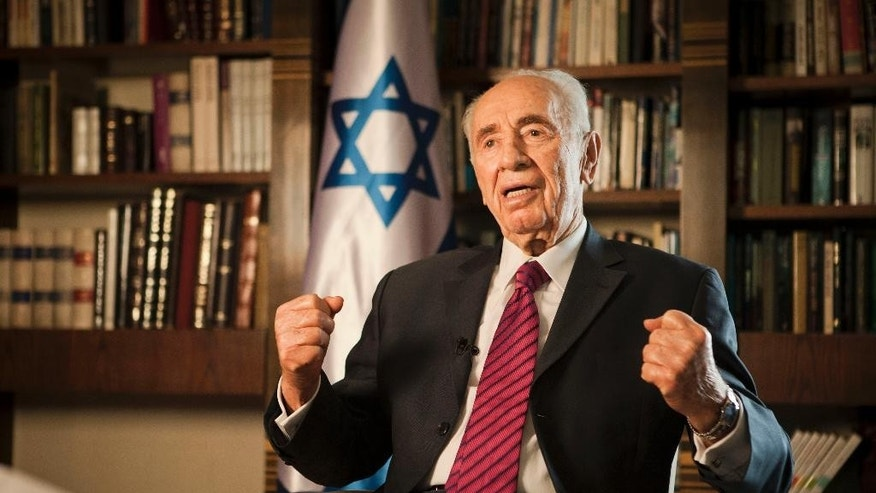 FILE - In this Tuesday, July 15, 2014, file photo, Israel's President Shimon Peres speaks during an interview with The Associated Press, at his residence in Jerusalem. Former Israeli President Shimon Peres on Tuesday, Sept. 13, 2016, suffered a stroke and was rushed to a hospital, where he was sedated and placed on a respirator ahead of a brain scan. (AP Photo/Dan Balilty, File)