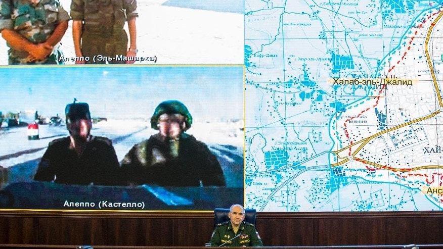 Lt.-Gen. Sergei Rudskoi, center, of the Russian Military General Staff listens to Russian and Syrian officers during a video call, as a Syrian army facility is displayed on screen, at a Russian Defense Ministry building in Moscow, Russia, Monday, Sept. 12, 2016. Rudskoi said that the Russian military will continue strikes against the Islamic State group and the al-Qaida's branch in Syria in coordination with the United States even as a cease-fire brokered by Moscow and Washington goes into effect Monday. (AP Photo/Alexander Zemlianichenko)