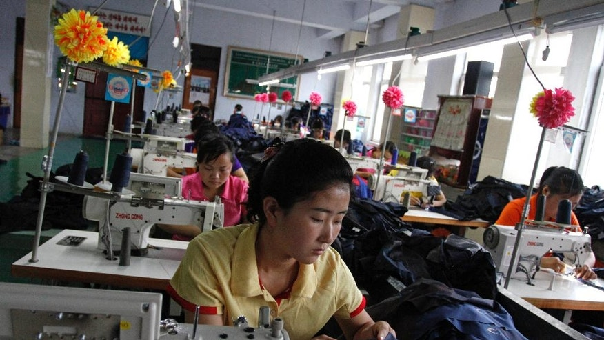 In this July 23, 2016 photo, seamstresses stitch together clothing at a factory in the Rason Special Economic Zone in North Korea. Even as North Korea is facing tough sanctions, the zone is by North Korean standards thriving. For countries spearheading efforts to impose even stronger sanctions against the North for its recent nuclear test, it's an irritating reminder that not everyone is onboard with the idea of shutting off trade with Pyongyang, especially when there is money to be made.  (AP Photo/Eric Talmadge)