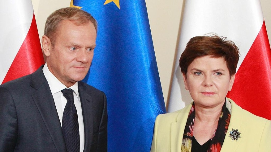 Poland's Prime Minister Beata Szydlo greets European Council President Donald Tusk prior to talks on EU future after Britain leaves, in Warsaw, Poland, Tuesday, Sept. 13, 2016. Ahead of EU summit on Friday, Szydlo says EU needs deep, bold reforms. Relations between Szydlo, a conservative, and Tusk, Poland's former centrist prime minister, are tense. (AP Photo/Czarek Sokolowski)
