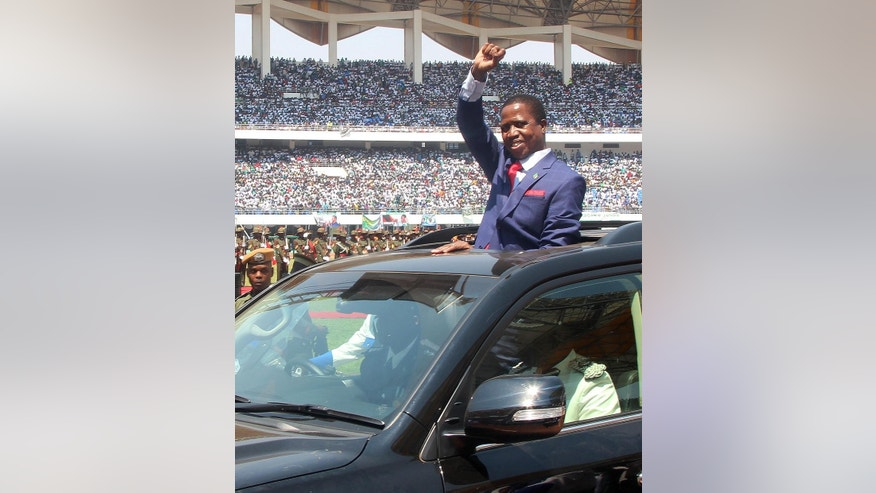 President Edgar Lungu of Zambia, waves to the crowd during his inauguration in Lusaka, Zambia, Tuesday, Sept. 13, 2016. Lungu, who was re-elected last month in a closely contested vote, was sworn in at an event attended by regional leaders, including Robert Mugabe of Zimbabwe and Ian Khama of Botswana. (AP Photo/Moses Mwape)