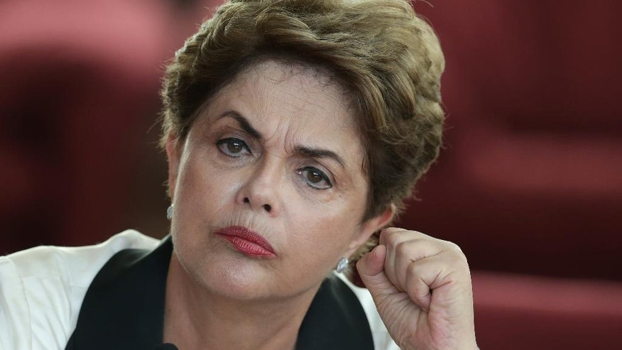 FILE - In this Sept. 2, 2016 file photo, Brazil's ousted President Dilma Rousseff listens to a reporter's question during a press conference at the official residence Alvorada Palace, in Brasilia, Brazil. Rousseff slammed the process that led to her ouster, promising to provide a strong opposition voice to the new government. (AP Photo/Eraldo Peres)