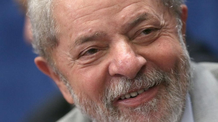 FILE - In this Aug. 29, 2016 file photo, Brazil's former President Luiz Inacio Lula da Silva attends the impeachment trial of suspended President Dilma Rousseff in Brasilia, Brazil. Federal investigators charged Lula with money laundering and corruption on Wednesday, Sept. 14, 2016 in connection with a sprawling corruption investigation at state-run oil giant Petrobras. (AP Photo/Eraldo Peres, File)