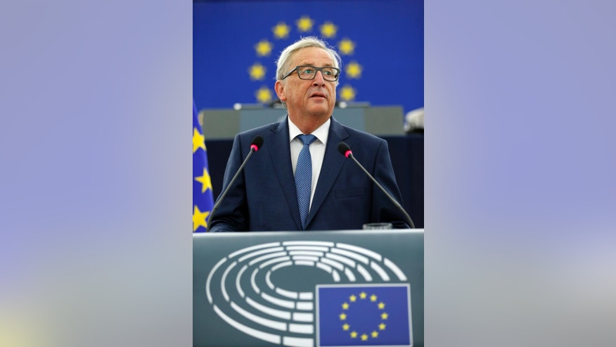 "EU Commission President Jean-Claude Juncker delivers his State of the Union address at the European Parliament in Strasbourg, eastern France, Wednesday, Sept. 14, 2016. Juncker, the head of the European Union's executive said that the EU ""still does not have enough Union"" and that the bloc still needs more united action to move forward in the face of widespread opposition to more centralized powers for the bloc. (AP Photo/Jean Francois Badias)"