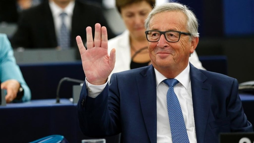 "EU Commission President Jean-Claude Juncker waves to the audience prior to deliver his State of the Union address at the European Parliament in Strasbourg, eastern France, Wednesday, Sept. 14, 2016. Juncker, the head of the European Union's executive said that the EU ""still does not have enough Union"" and that the bloc still needs more united action to move forward in the face of widespread opposition to more centralized powers for the bloc. (AP Photo/Jean Francois Badias)"