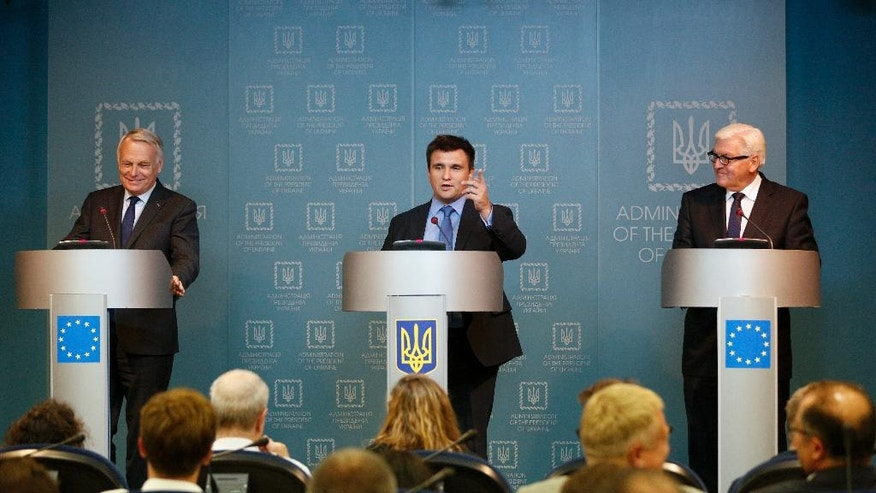 From left, French Foreign Minister Jean-Marc Ayrault, Ukrainian Foreign Minister Pavlo Klimkin and German Foreign Minister Frank-Walter Steinmeier attend a news conference after their meeting with Ukrainian President Petro Poroshenko in Kiev, Ukraine, Wednesday, Sept. 14, 2016. (AP Photo/Sergei Chuzavkov)
