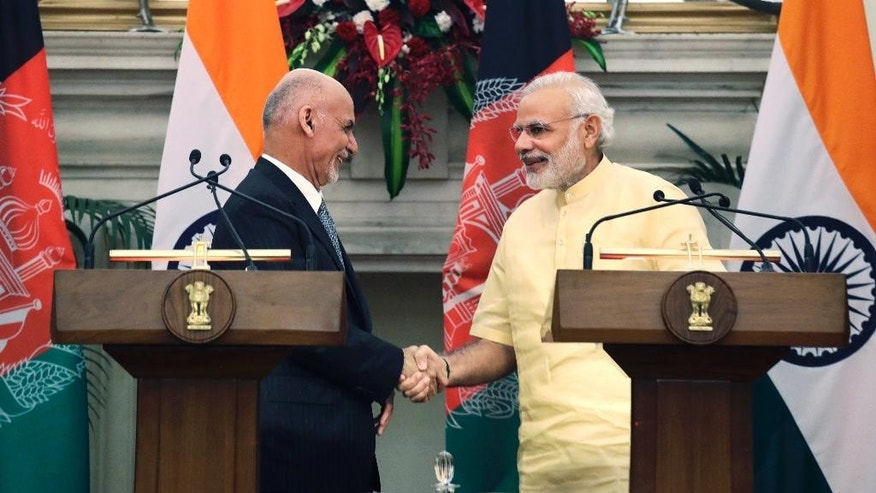 Indian Prime Minister Narendra Modi, right, shakes hands with Afghan President Ashraf Ghani after signing of bilateral agreements in New Delhi, India, Wednesday, Sept. 14, 2016. Ghani is on a two-day visit to India. (AP Photo/Manish Swarup)