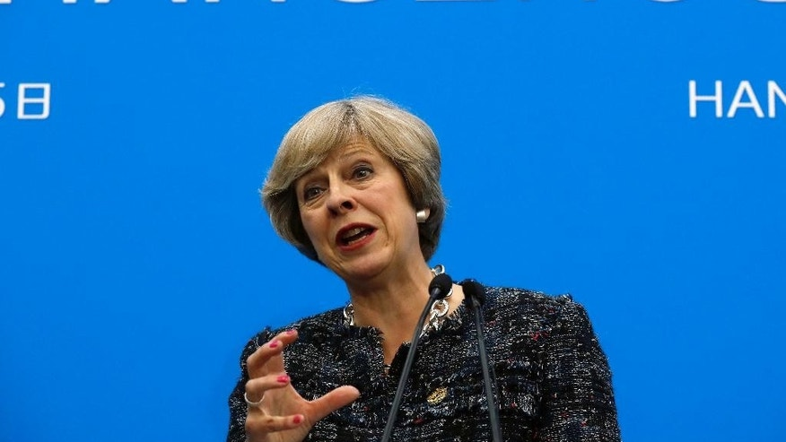 FILE - In this Monday, Sept. 5, 2016 file photo, British Prime Minister Theresa May speaks at a press conference held at the end of the G-20 summit in Hangzhou in eastern China's Zhejiang province. Since the U.K. voted to leave the European Union, Prime Minister Theresa May has said it again and again: Brexit means Brexit.Despite the mantra, it's far from clear what a British exit from the bloc will look like. Almost three months after the vote, Britons and Europeans still don't know when the departure will happen and how it will affect their work, travel, pocketbooks and prospects.(AP Photo/Ng Han Guan, file)