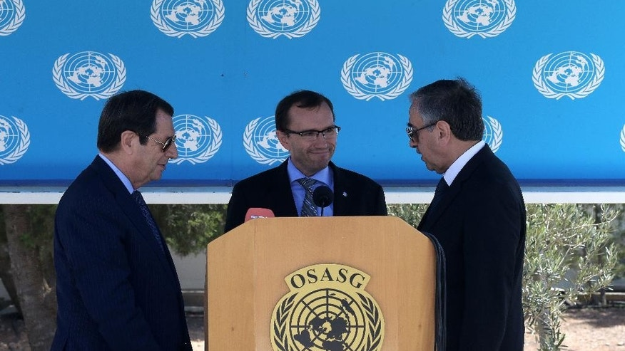 Cypriot President Nicos Anastasiades, left, breakaway Turkish Cypriot leader Mustafa Akinci, right, and UN Special Advisor of the Secretary-General Espen Barth Eide are seen during a statement after Their talks aimed at reunifying the ethnically divided island, at the disused Nicosia airport inside a United Nations controlled buffer zone on Wednesday, Sept. 14, 2016. The rival leaders of ethnically split Cyprus say they will meet with the U.N. Chief later this month to take stock of ongoing reunification talks and ask him to step up his personal involvement in the months ahead. (AP Photo/Petros Karadjias)