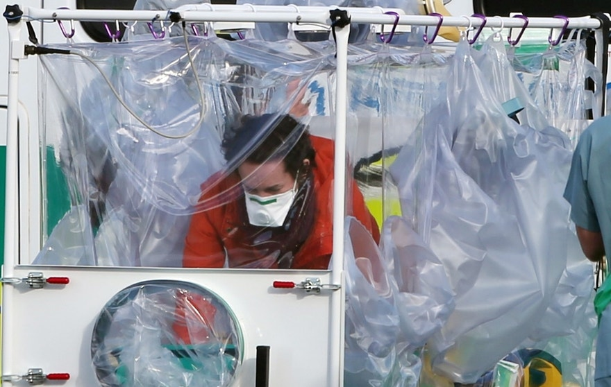 FILE - This is a Feb. 23, 20116  file photo ofof Ebola nurse Pauline Cafferkey being transported to militar aircraft at Glasgow Airport, in Scotland  before being flown to London for treatment. Cafferkey who contracted Ebola while working in Sierra Leone has been cleared of misconduct charges. The Nursing and Midwifery Council said Wednesday Spet. 14, 2016, after a two-day hearing that Pauline Cafferkey had not conducted herself improperly. (Andrew Milligan/PA, File, via AP)