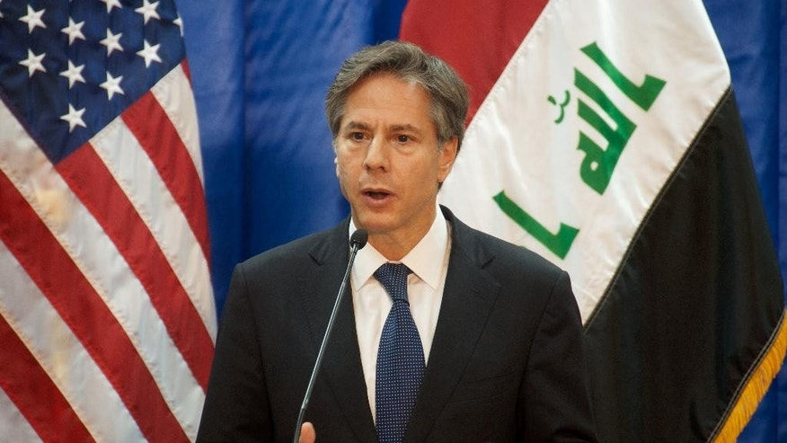 In this image released by the U.S. State Department, Deputy Secretary of State Antony Blinken speaks to reporters in Baghdad on Wednesday, Sept. 14, 2016. Blinken says Iraqi forces backed by the U.S.-led coalition have retaken half the territory the Islamic State group once held in the country. He also announced $181 million to address a humanitarian crisis that has festered in Iraq despite progress on the battlefield. (U.S. State Department via AP)