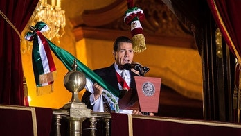 MEXICO CITY, MEXICO - SEPTEMBER 15: Mexico's President Enrique Pen–a Nieto delivers a speech flag after giving the traditional 'El Grito', during the anniversary of the 'Grito de Dolores' made by the priest Miguel Hidalgo in 1810 to begin the struggle for independence against Spain as part of Mexican Independence celebrations at Palacio Nacional on September 15, 2015 in Mexico City, Mexico. (Photo by Manuel Velasquez/Anadolu Agency/Getty Images)