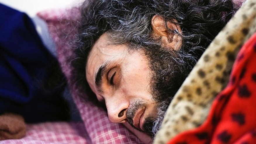 FILE - In this Sept. 9, 2016 file photo, Syrian native Abu Wa'el Dhiab rests in bed while conversing with his family via a laptop, in his apartment in Montevideo, Uruguay. An Uruguayan official said on Sept. 14 that the health of the resettled former Guantanamo detainee has taken a turn for the worse due to a hunger strike he launched to demand relocation to another country. He says he no longer wants to remain in Uruguay and would like to join his wife and daughters in Turkey. Uruguayan officials say they are trying to find another country to accept him. (AP Photo/Matilde Campodonico, File)
