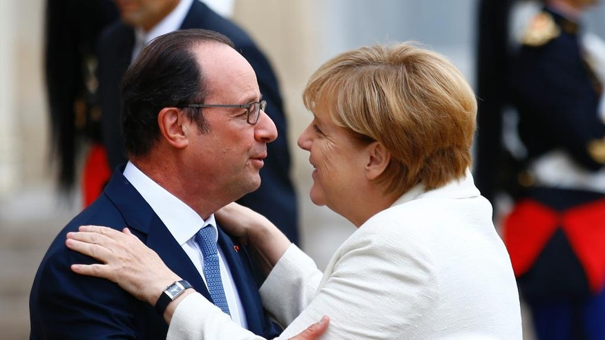 French President Francois Hollande greets German Chancellor Angela Merkel prior to their meeting at the Elysee Palace in Paris, Thursday, Sept. 15, 2016. Merkel and Hollande meet in Paris to coordinate their strategies for an EU without Britain ahead of a key EU summit in Bratislava, Slovakia. (AP Photo/Francois Mori)
