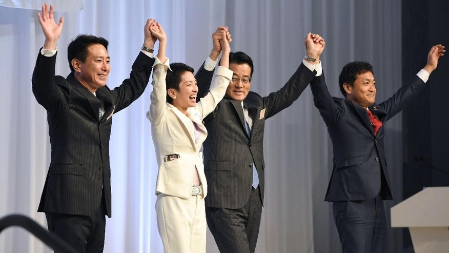 Newly elected Democratic Party leader Renho Murata, second left, smiles as she raises hands with her predecessor Katsuya Okada, second right, and her rival candidates, Seiji Maehara, left, and Yuichiro Tamaki, right, upon her election in Tokyo Thursday, Sept. 15, 2016. Murata, who generally goes by only her first name, is a woman, one of three who have assumed prominent political posts in recent weeks in a country more known for its male-dominated political and business hierarchy. Her election Thursday followed that of Tokyo's first female leader on July 31, and the appointment of a woman as defense minister later the same week. (Akiko Matsushita/Kyodo News via AP)