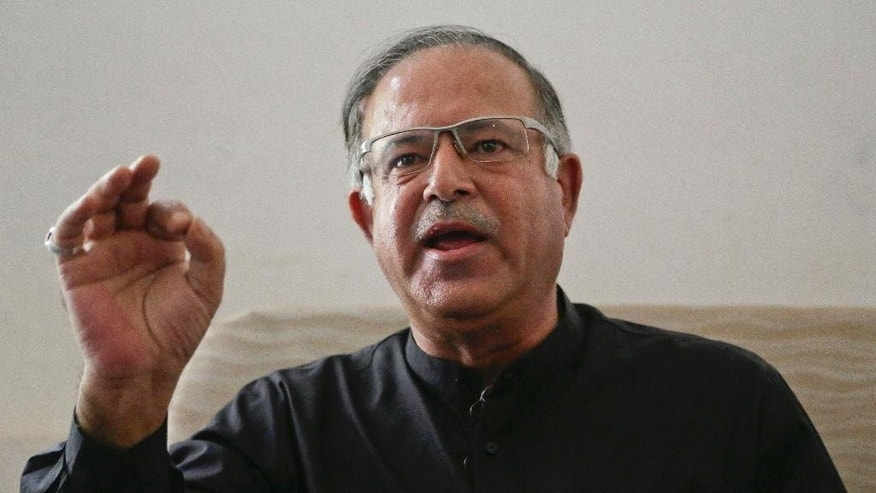 Tariq Hameed Karra, lawmaker and a founding member of Kashmir's People's Democratic Party, addresses a press conference  in Srinagar, Indian controlled Kashmir, Thursday, Sept. 15, 2016. Kara, a prominent pro-India Kashmiri politician has resigned from India's Parliament and from his regional party to protest a government crackdown in Kashmir that prevented people from offering Eid prayers for the first time in the troubled region. (AP Photo/Mukhtar Khan)