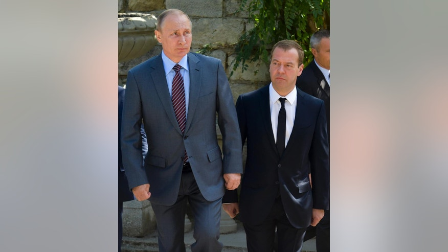 Russian President Vladimir Putin, left, and Prime Minister Dmitry Medvedev visit Mithridates Hill while sightseeing Kerch, Crimea, Thursday, Sept. 15, 2016. President Vladimir Putin and Prime Minister Dmitry Medvedev arrived in Kerch to attend a meeting of the State Council presidium on transport system in the south. (Alexander Astafyev/Sputnik, Government Pool Photo via AP)