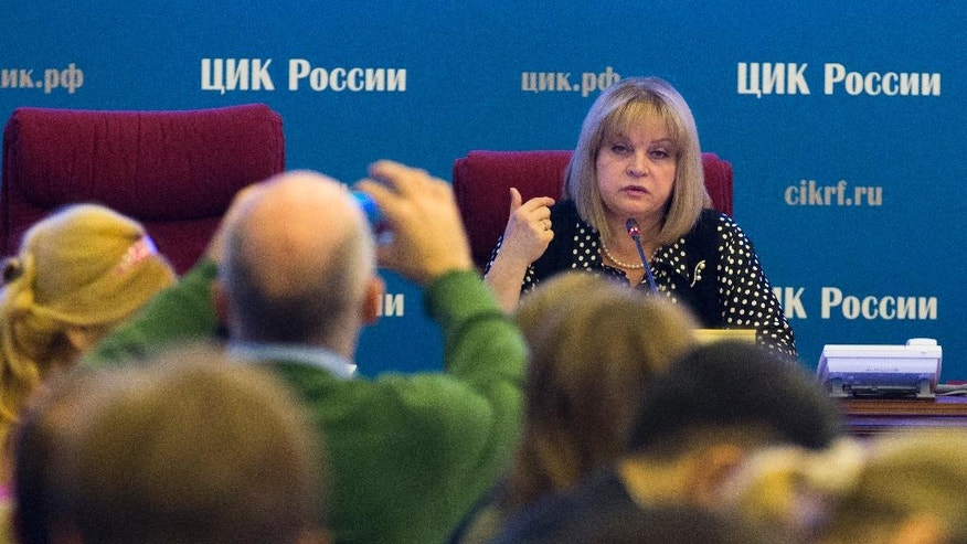 Ella Pamfilova, head of Russian Central Election Commission, facing camera, speaks in the commission headquarters in Moscow, Russia on Thursday, Sept. 15, 2016. Russia is preparing to hold a parliamentary election on Sunday, Sept. 18. (AP Photo/Ivan Sekretarev)