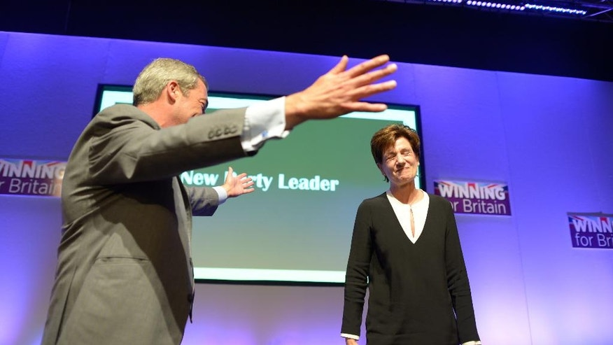 Diane James celebrates with Nigel Farage after being named as the new leader of the UK Independence Party at the party's annual conference in Bournemouth, England, Friday, Sept. 16, 2016. Britain's right-wing U.K. Independence Party has chosen European Parliament member Diane James as its leader, replacing the charismatic but divisive Nigel Farage.  James defeated four other candidates in a ballot of party members.  (Ben Birchall/PA via AP)