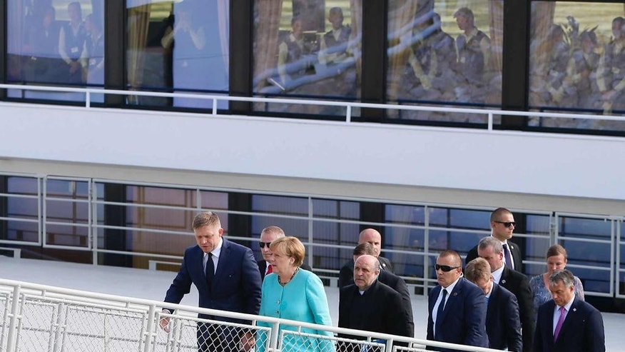 Slovakian Prime Minister Robert Fico, left, German Chancellor Angela Merkel and Hungarian Prime Minister Viktor Orban, right, alight after taking a boat down the Danube river during an EU summit in Bratislava, Slovakia, Friday, Sept. 16, 2016. An EU summit, without the participation of the United Kingdom, in Bratislava will kick off the discussion on the future of EU following Brexit. (AP Photo/Virginia Mayo)