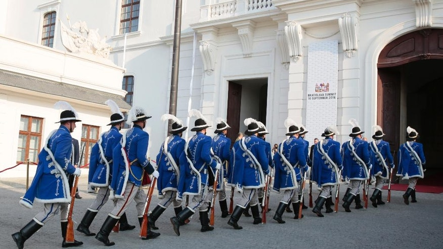 Palace Guards arrive for an EU summit at Bratislava Castle in Bratislava on Friday, Sept. 16, 2016. An EU summit, without the participation of the United Kingdom, will kick on Friday discussion on the future of the EU following Brexit. (AP Photo/Virginia Mayo)