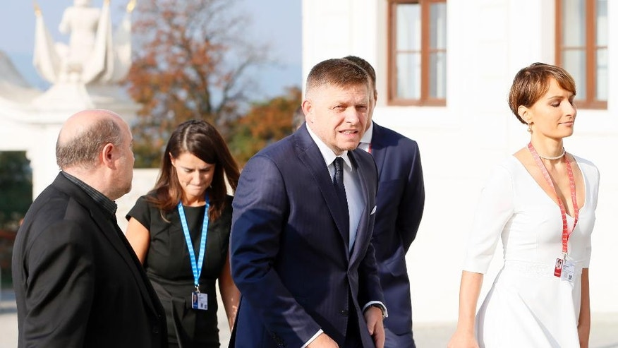 Slovakian Prime Minister Robert Fico, center, arrives for an EU summit at Bratislava Castle in Bratislava on Friday, Sept. 16, 2016. An EU summit, without the participation of the United Kingdom, will kick off on Friday with discussion on the future of the EU following Brexit. (AP Photo/Virginia Mayo)