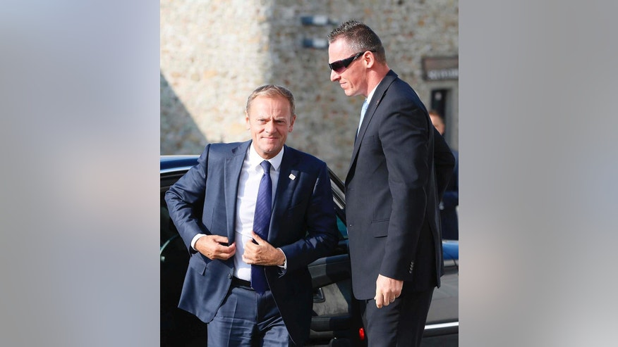 President of the European Council Donald Tusk, left, arrives for an EU summit at Bratislava Castle in Bratislava on Friday, Sept. 16, 2016. An EU summit, without the participation of the United Kingdom, in Bratislava will kick off the discussion on the future of EU following Brexit. (AP Photo/Virginia Mayo)