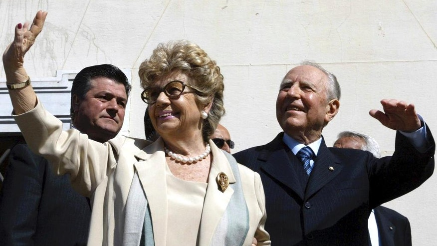 FILE - This May 3, 2006 file photo shows Italian President Carlo Azeglio Ciampi, right, and his wife Franca waving during their visit to the city of Leghorn, Italy. Ciampi died on Friday, Sept. 16, 2016 at the age of 95 after a long illness.  (AP Photo/Fabio Muzzi, files)