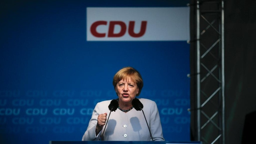German Chancellor Angela Merkel delivers her speech during an election campaign rally of her Christian Democratic Union party for the Berlin mayor elections in Berlin, Wednesday, Sept. 14, 2016. The German federal state of Berlin will hold elections for the city's parliament on Sunday, Sept. 18. (AP Photo/Markus Schreiber)