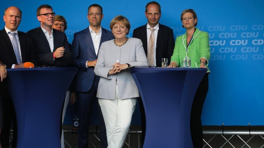 German Chancellor Angela Merkel, 3rd from right, attends an election campaign of her Christian Democratic Union party for the Berlin mayor elections in Berlin, Wednesday, Sept. 14, 2016. The German federal state of Berlin will hold elections for the city's parliament on Sunday, Sept. 18, 2016. (AP Photo/Markus Schreiber)