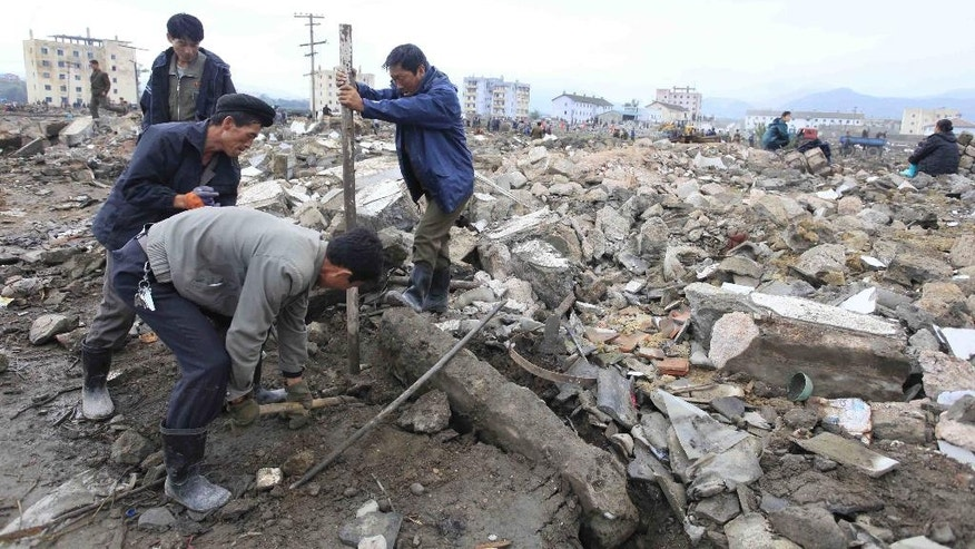 Workers recover cement blocks flood-damaged areas in Onsong, North Hamgyong Province, North Korea, Friday, Sept. 16, 2016. North Korean soldiers and relief teams rushed to clear roads and railway tracks, build shelters and provide food and sanitation Friday to tens of thousands of residents in a remote part of the country near the Chinese border that was devastated by heavy downpours and flash-floods when a typhoon pounded their villages last week. (AP Photo/Kim Kwang Hyon)