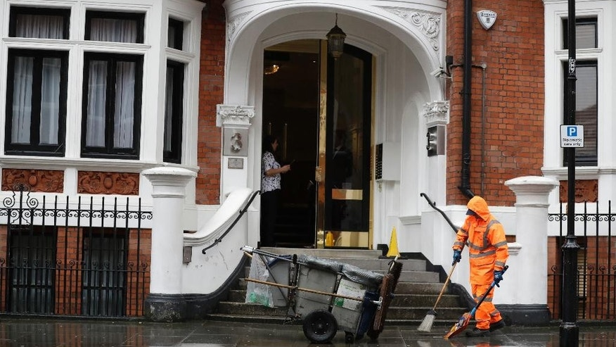 A street cleaner works outside the Ecuadorian Embassy in London, Friday, Sept. 16, 2016. A Swedish appeals court has upheld a detention order for WikiLeaks founder Julian Assange, who is wanted by prosecutors in a rape investigation. The decision Friday by the Svea Court of Appeal means that the arrest warrant stands for the 45-year-old Australian, who has avoided extradition to Sweden by seeking shelter at the Ecuadorian Embassy in London since 2012. (AP Photo/Kirsty Wigglesworth)
