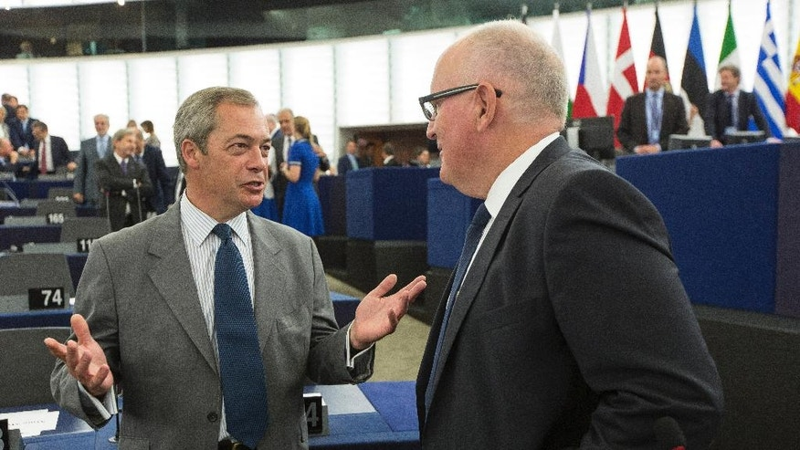 "Nigel Farage, left, ex-leader of the British UKIP party and member of the European Parliament, discusses with Frans Timmermans, first vice president of the European commission, at the European Parliament in Strasbourg, eastern France, Wednesday, Sept. 14, 2016. EU Commission President Jean-Claude Juncker said in his State of the European Union address to the European parliament that the EU ""still does not have enough Union.""(AP Photo/Jean-Francois Badias)"